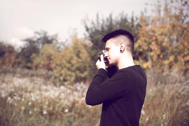 Hipster guy with retro camera picture id862712050?b=1&k=6&m=862712050&s=612x612&w=0&h=bs2z woe7lawiqscyk5z5c4vlvfgiqgbtazcbuyai5w=