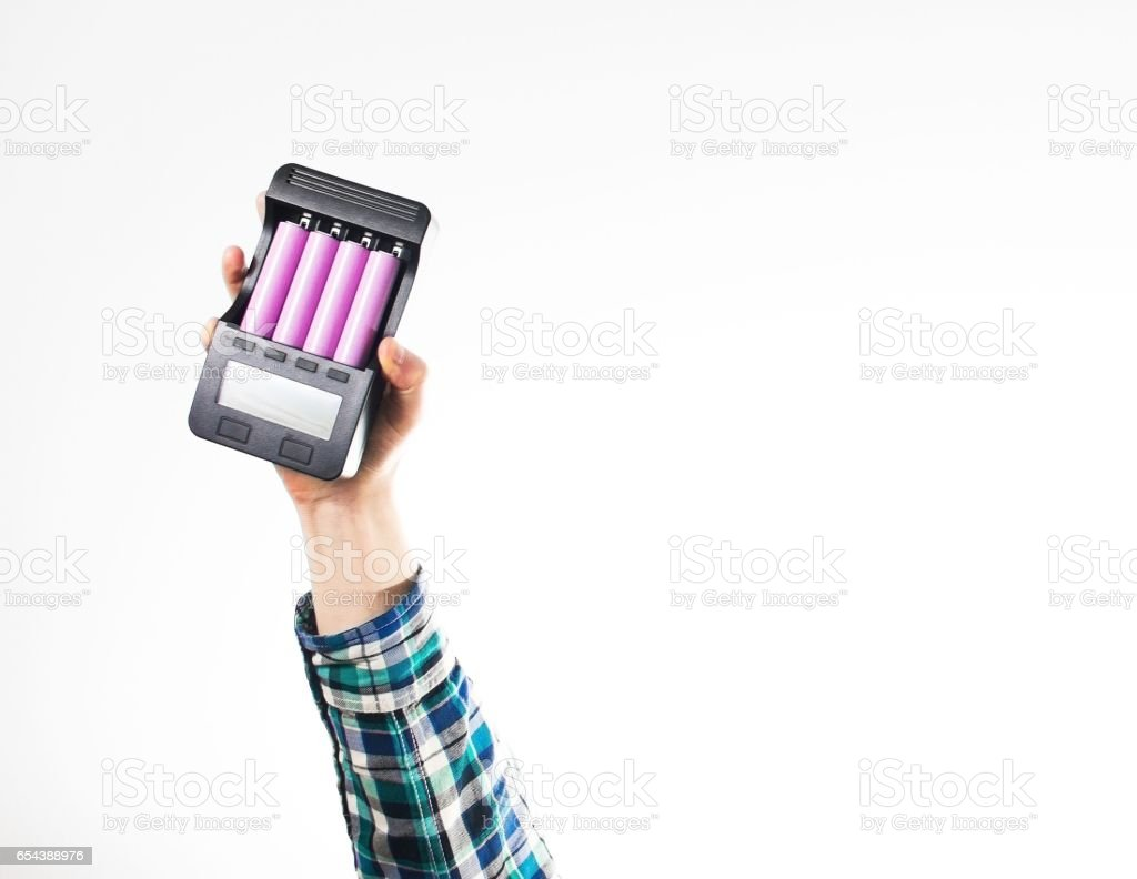 hipster hand in plaid shirt hold Battery charger with aaa,aa, 18 stock photo