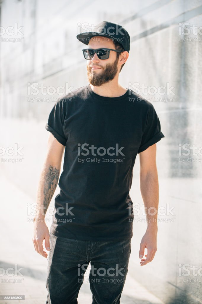14798fbd Hipster handsome male model with beard wearing black blank t-shirt with  space for your