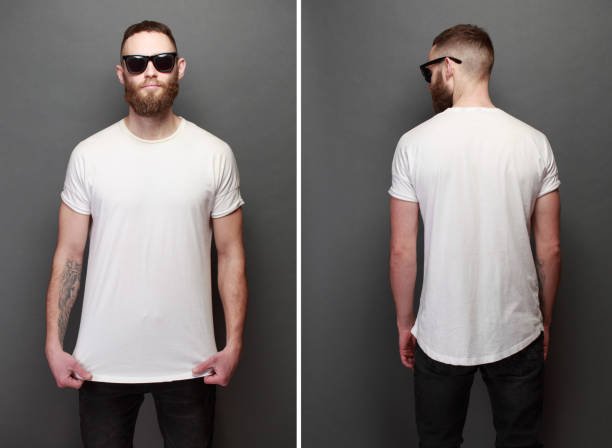 hipster handsome male model with beard wearing white blank t-shirt and a baseball cap with space for your logo or design in casual urban style - teeshirt template imagens e fotografias de stock
