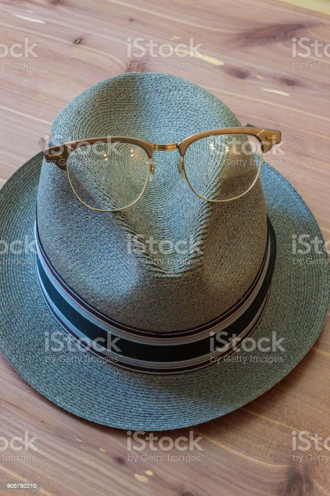Hipster hat with horn rimmed glasses on top, modern concept stock photo