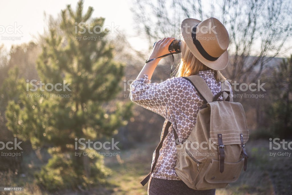 hipster hiker backpacker looking wild life royalty-free stock photo
