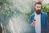 istock Hipster in a vineyard 1181440860