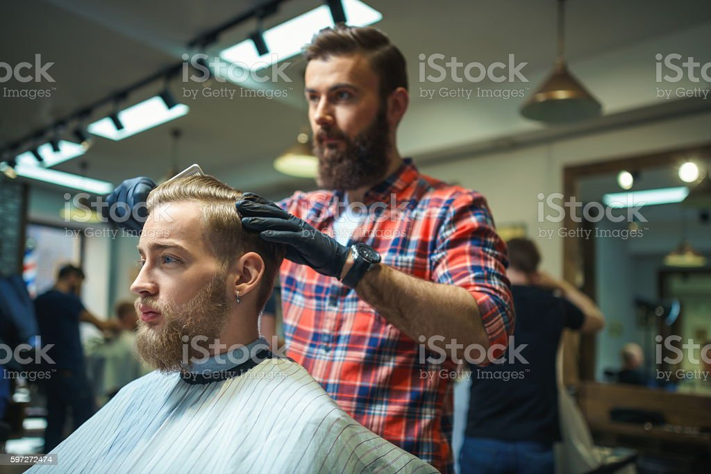 Hipster in barber shop royalty-free stock photo