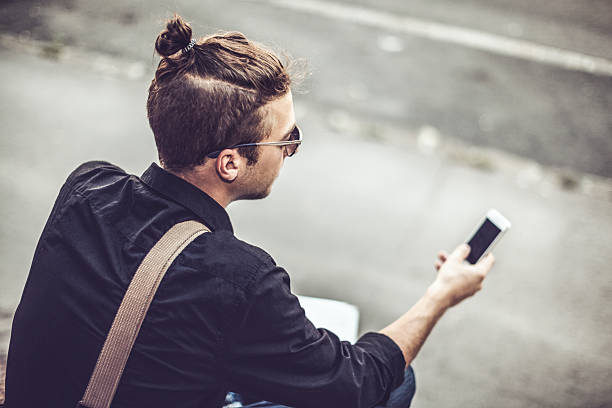 Hipster in the city Hipster in the city man bun stock pictures, royalty-free photos & images