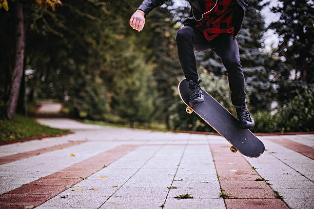 hipster jumping with a skateboard - skateboarding stock pictures, royalty-free photos & images
