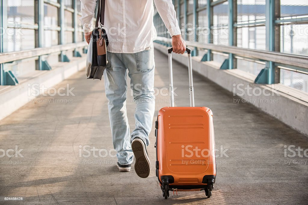 Hipster Male Walking on Bridge with Suitcase – Foto
