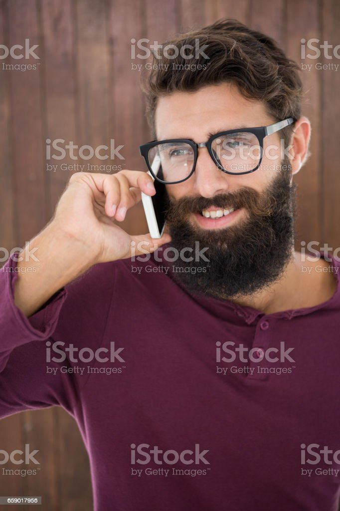 Hipster man calling someone royalty-free stock photo