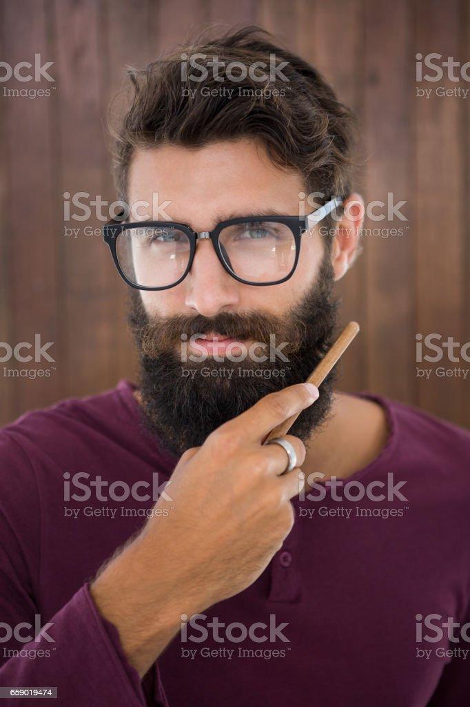 Hipster man doing his beard royalty-free stock photo