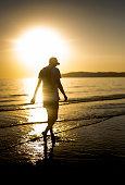 istock Hipster man enjoying the sunset 1058446346