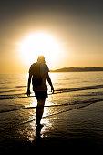 istock Hipster man enjoying the sunset 1058446426