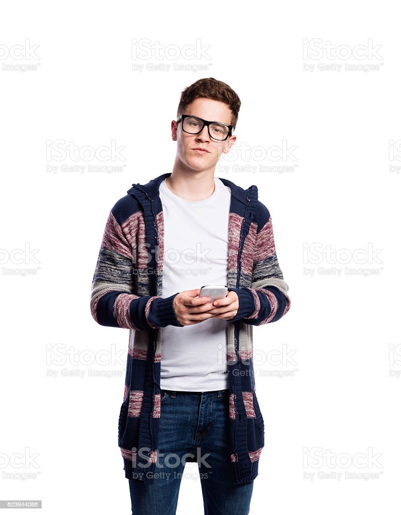 Hipster man holding smartphone, talking. Isolated. stock photo