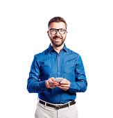 istock Hipster man in blue denim shirt, studio shot, isolated 612399294