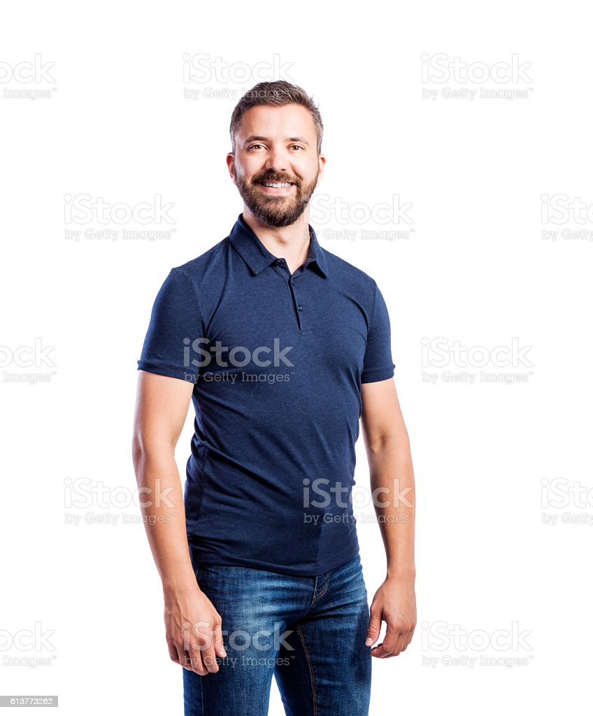 Hipster man in blue t-shirt. Studio shot, isolated. stock photo