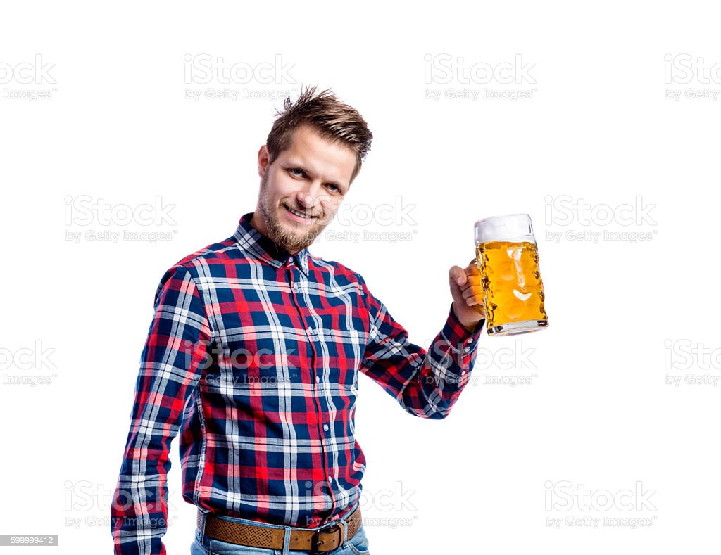 Hipster man in checked shirt holding beer, studio shot - foto de stock