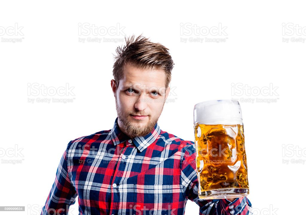 Hipster man in checked shirt holding beer, studio shot stock photo