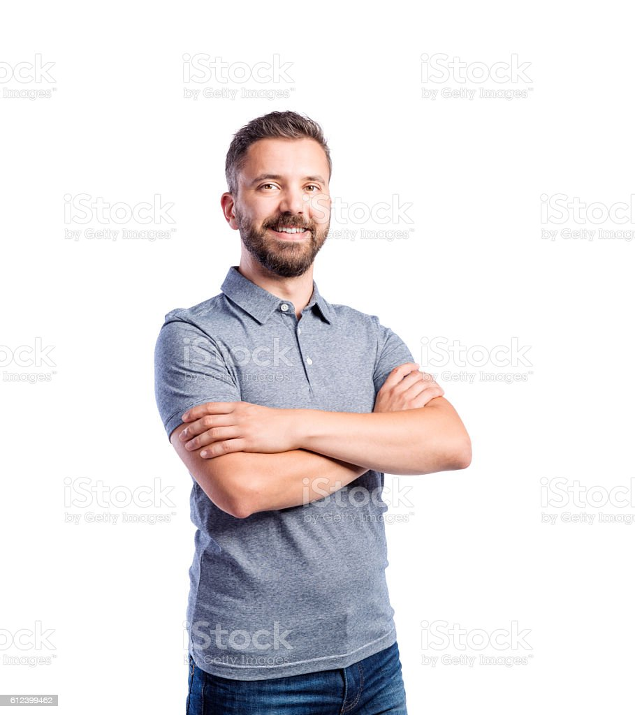 Hipster man in gray t-shirt, studio shot, isolated stock photo