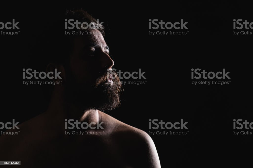 Hipster man looking with dark stock photo