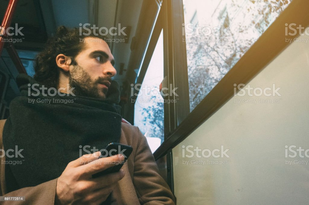 Hipster man on a bus - foto stock