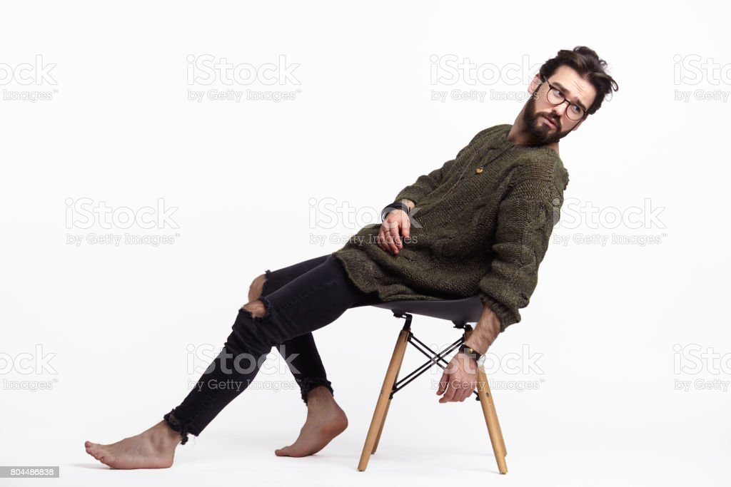 Hipster man posing on chair stock photo