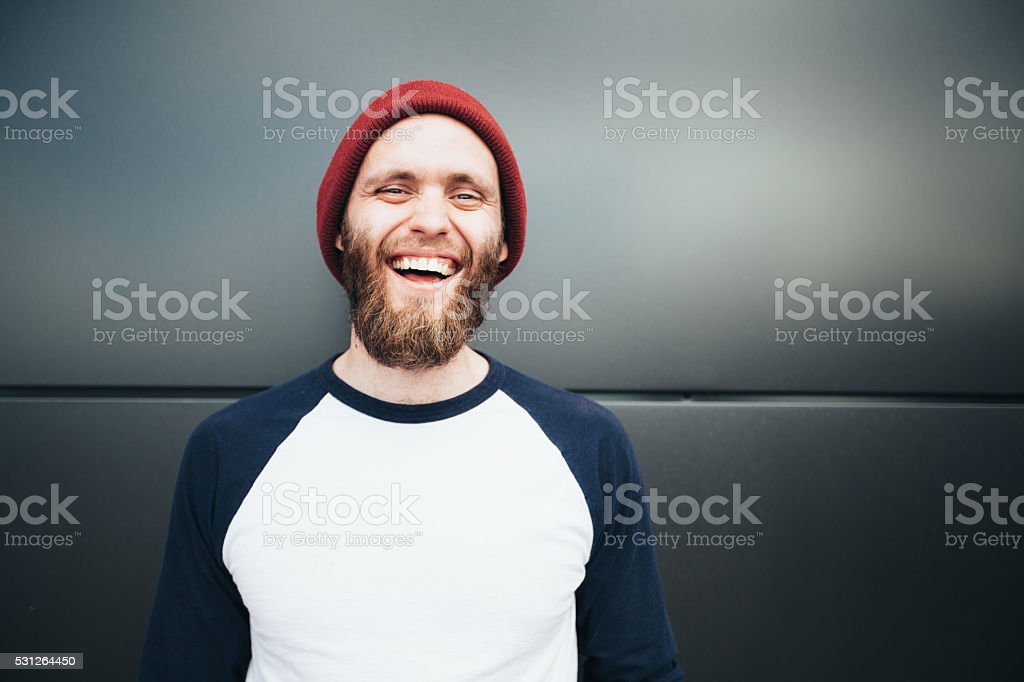 Hipster man smiling and wearing a hat stock photo