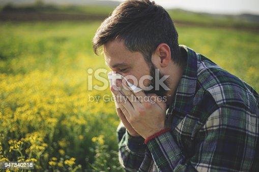istock Hipster man Sneezing 947340218