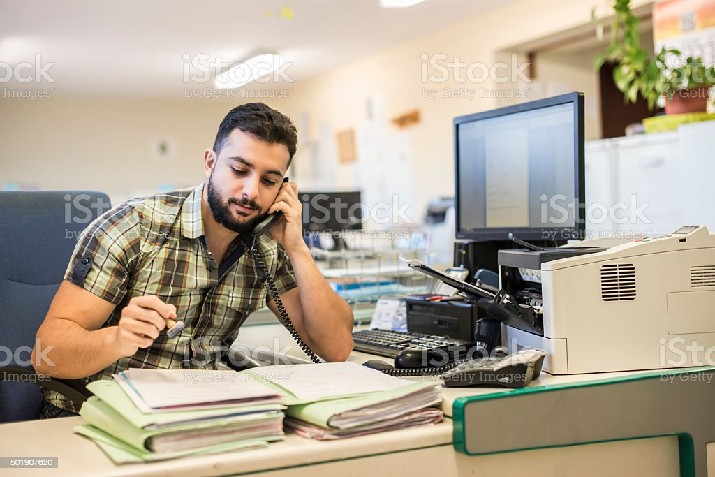 hipster man style working at office with ambient light stock photo