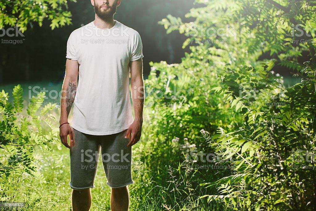 Hipster man wearing white blank t-shirt stock photo