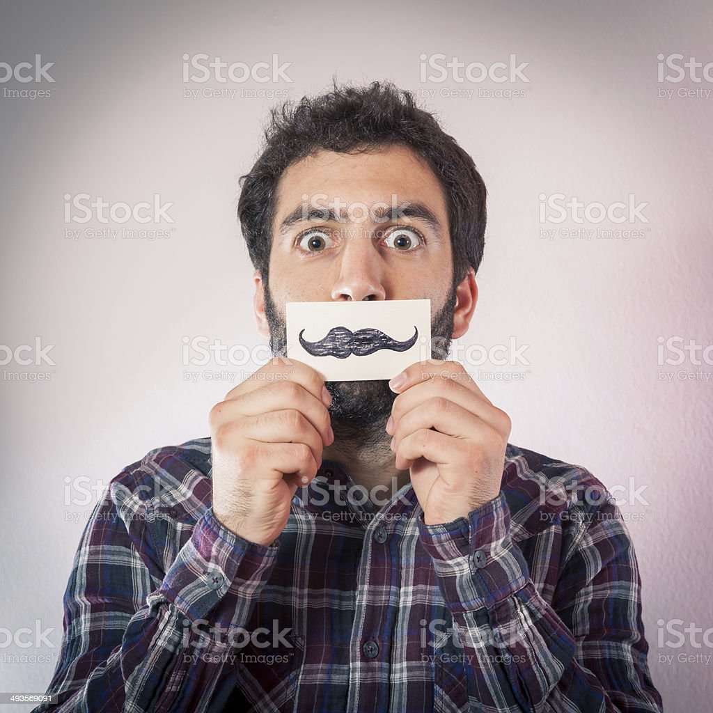 hipster man with fake paper moustaches stock photo