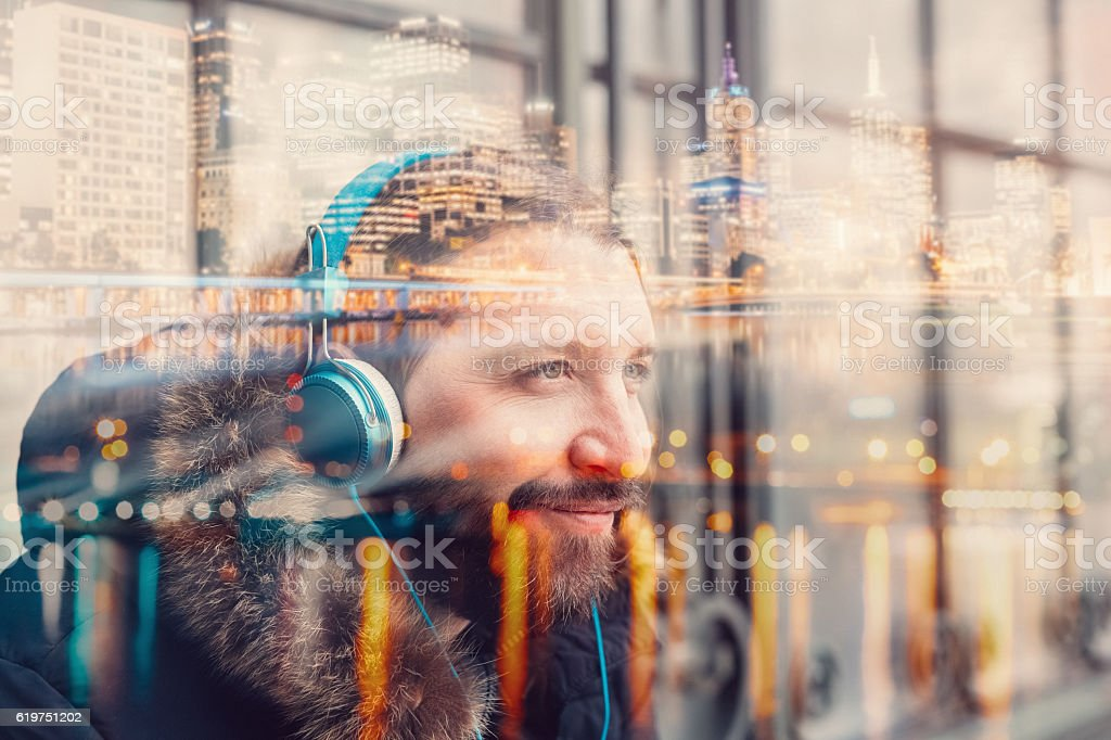 Hipster man with headphones in the city stock photo