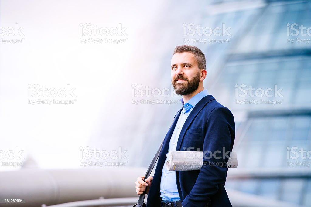 Hipster manager in blue shirt, London City Hall stock photo