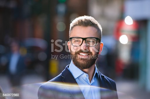 istock Hipster manager in blue shirt walking in the street 540372560