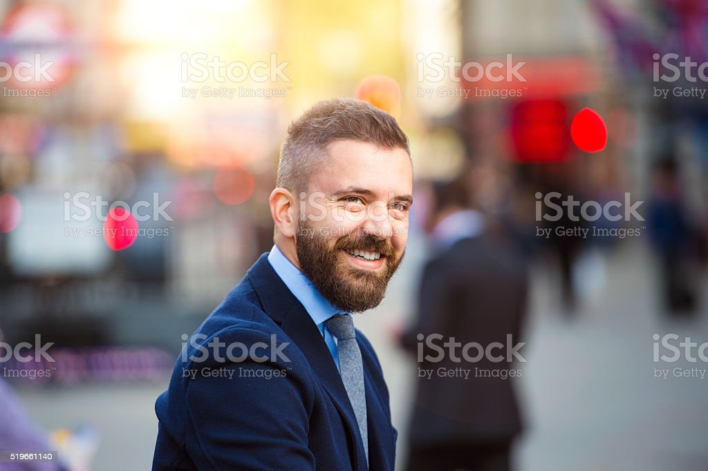 Hipster manager in the crowded street of London, Piccadilly Circ stock photo