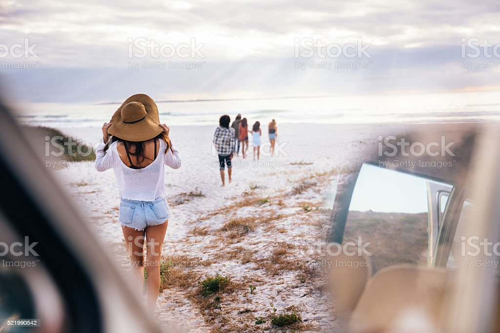 Hipster Multi-Ethnic Group of friends Walking on Beach stock photo