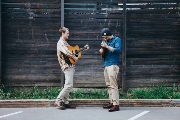 Hipster musicians are playing on the street. stock photo