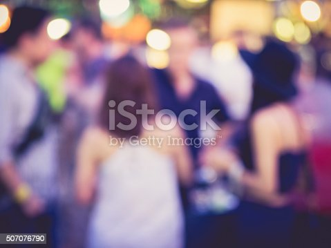 istock Hipster Party Men and women in Festival Event Blurred Background 507076790