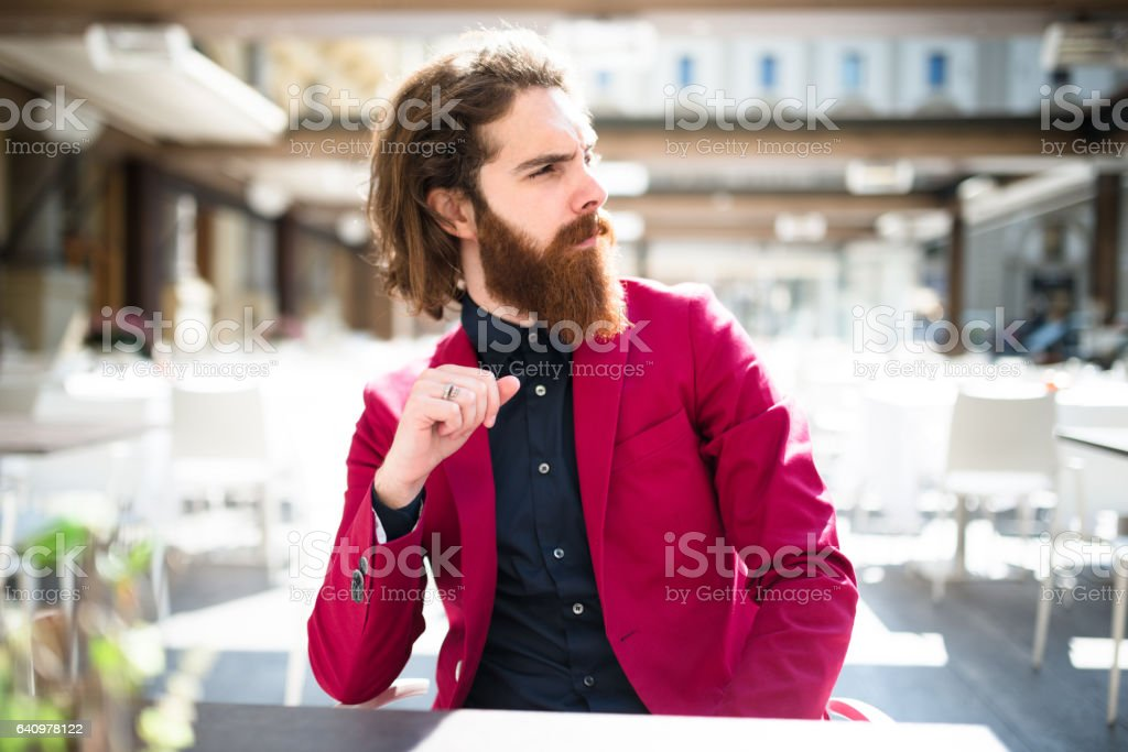 hipster pensive sitting at the cafe stock photo