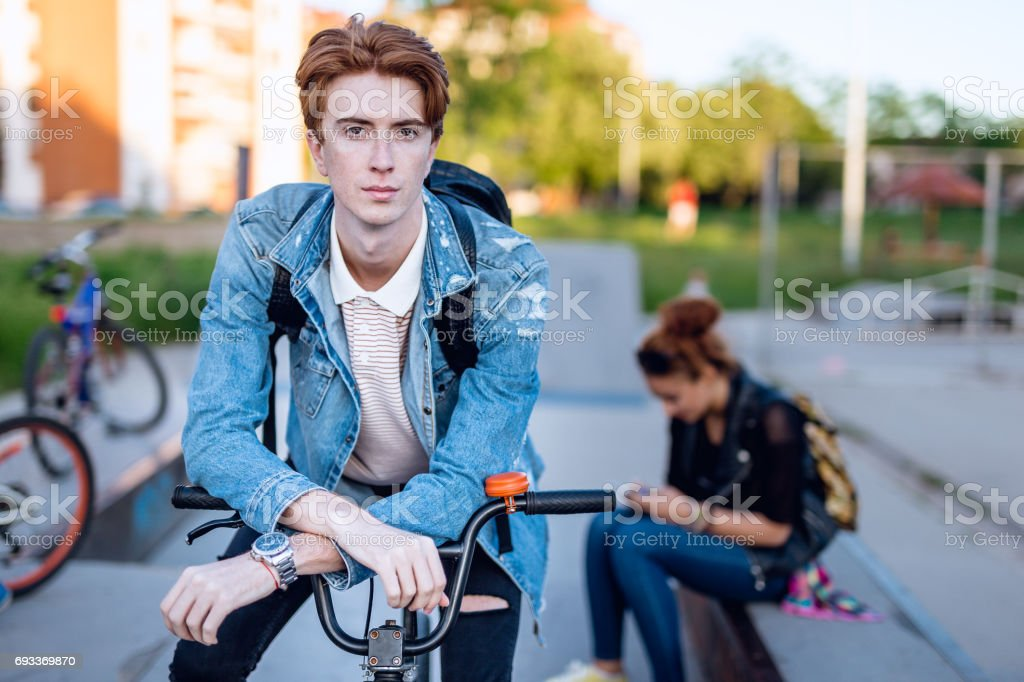 Hipster person on BMX stock photo