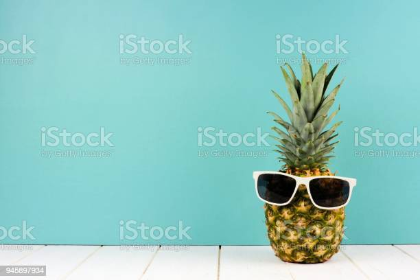 Hipster pineapple with sunglasses against turquoise picture id945897934?b=1&k=6&m=945897934&s=612x612&h=nps7rraq6pstra76b0oxbipmutm2e oyvqle4rj3kn4=