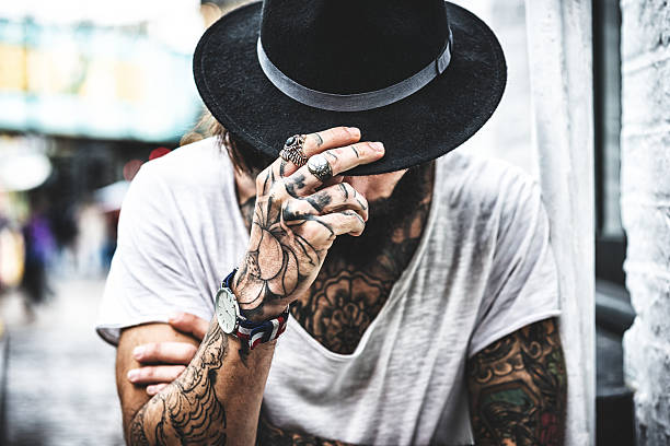 hipster portrait with tattoo - tattoo stock photos and pictures