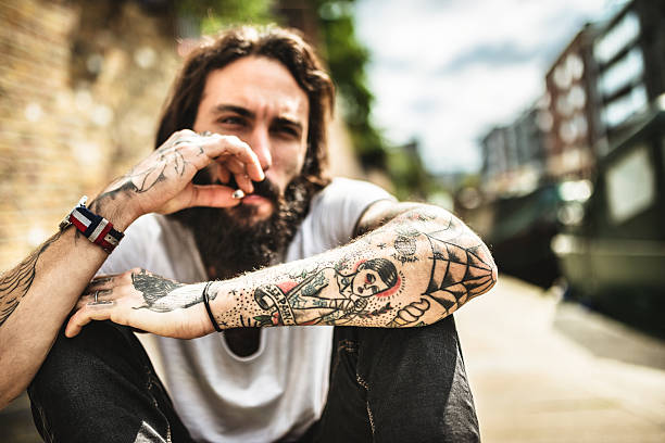 Tattoo Stock Photos: Royalty Free Tattoo Men Smoking Cigarette Pictures, Images