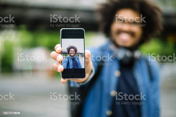 Hipster showing his selfie picture id1007370658?b=1&k=6&m=1007370658&s=612x612&h=dtji2sfoqnsqgxcwah9trncwfoxwjk25bbhwpzttlu0=