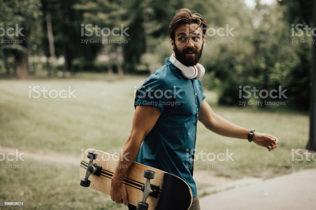 Hipster skater on the move stock photo