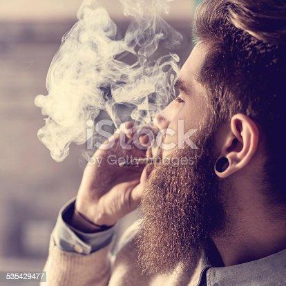 istock Hipster smoking pot. 535429477