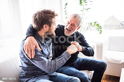istock Hipster son with his senior father at home. 906716212