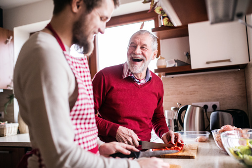 istock Hipster son with his senior father cooking in the kitchen. 906715880