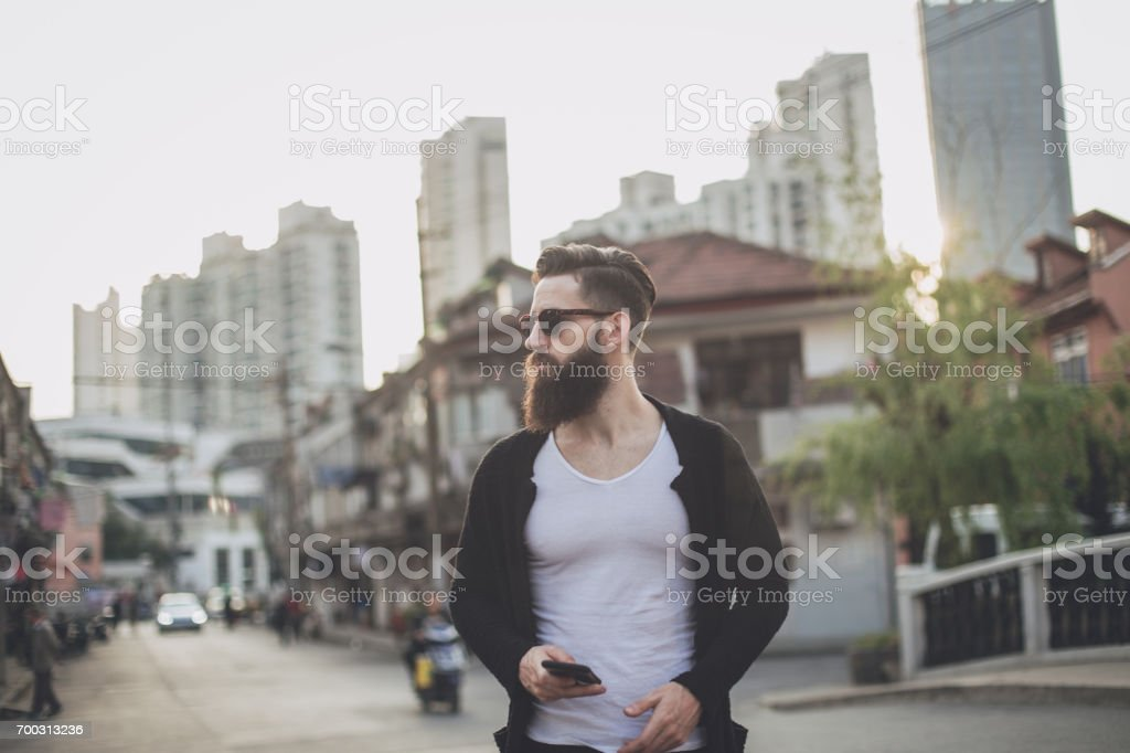 Hipster standing downtown stock photo