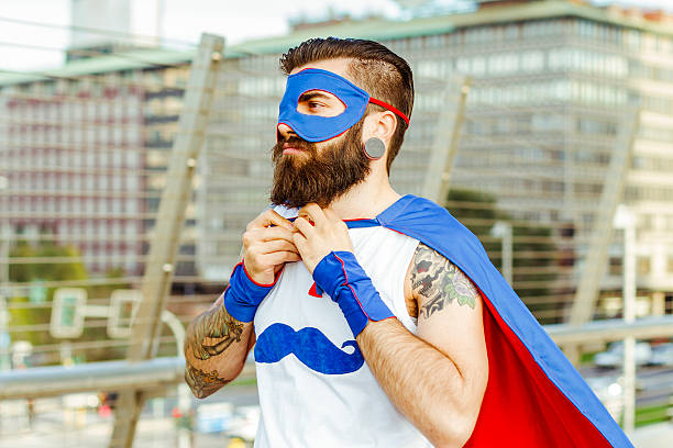 hipster-superheld anpassung seine mantle - city joke stock-fotos und bilder