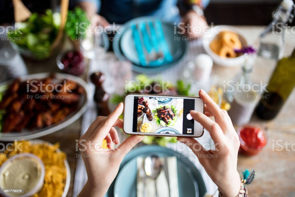 Hipster taking photo for social media before eating it stock photo