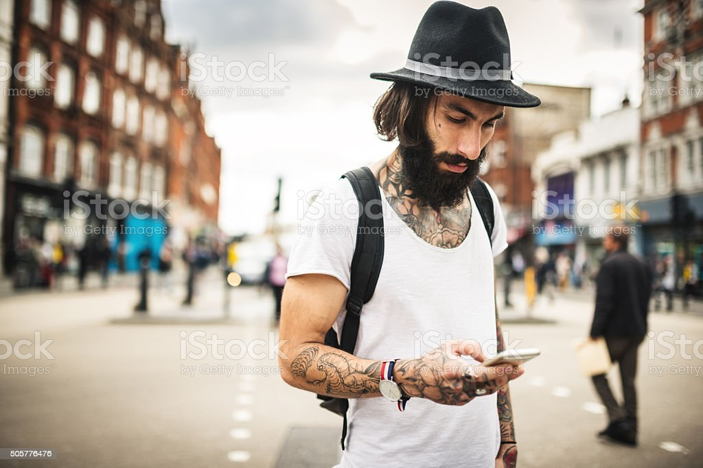Hipster text messaging in London stock photo